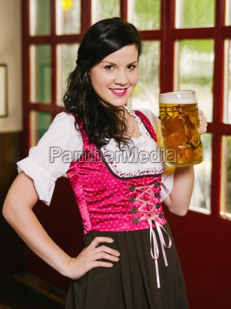 beautiful woman drinking oktoberfest beer