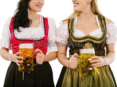 women with dirndl and oktoberfest beer