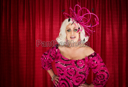 eccentric drag queen with hands on