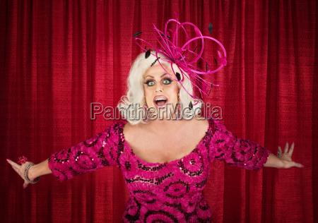 blond drag queen singing