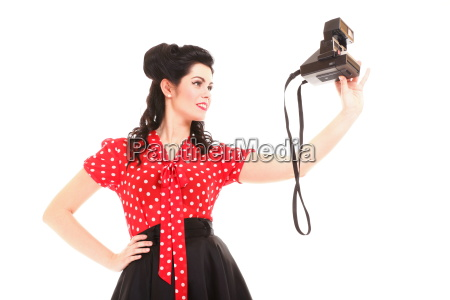 smiling retro girl with vintage camera