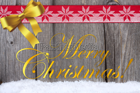 christmas greetings on wooden board
