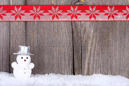 weihnachtshintergrund mit schneemann