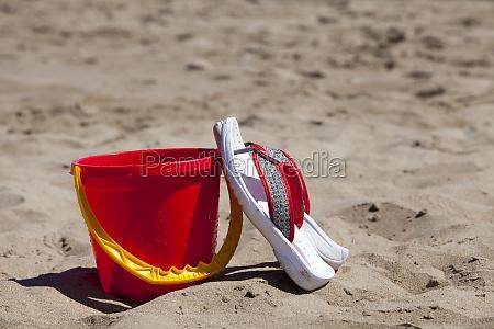 flip flops leaned on a red
