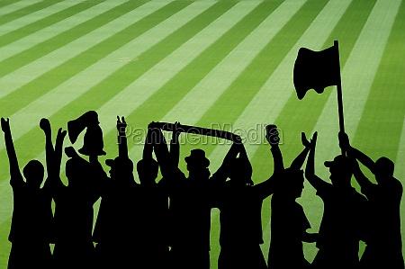silhouette von jubelnden fussballfans