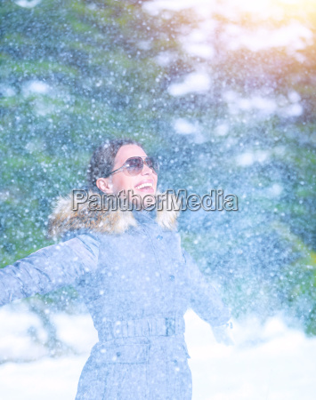 excited female under snowfall