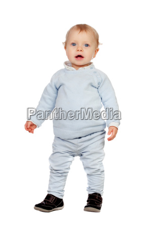adorable blonde baby standing isolated on