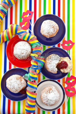 fresh donuts on colorful plates