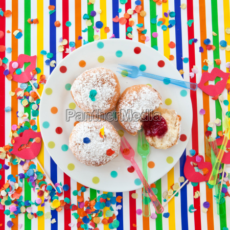 fresh donuts on colored plate