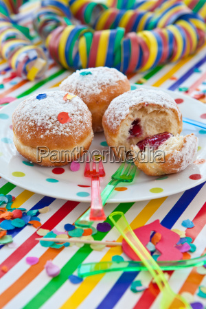 fresh donuts on colorful dish