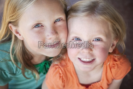 a portrait of two sisters smiling