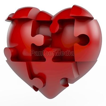 rotes puzzlespielstueckinneres herz teilte in puzzlespielstuecke