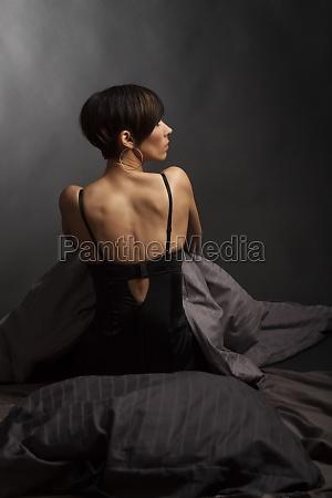 back of a brunette woman in