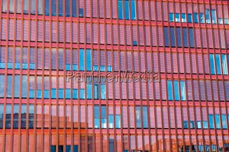 red glass facade of an office