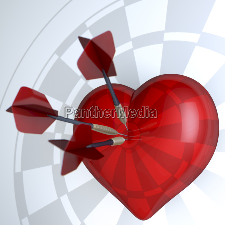 red heart dartboard with darts in