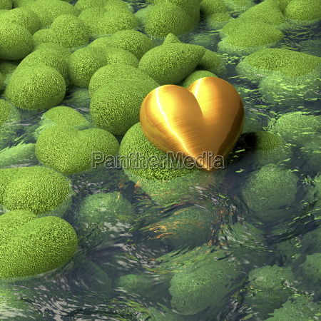 golden heart lying on mossy heart