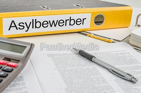 file folders labeled asylum