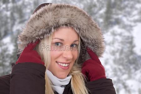 young woman in winter wears jacket