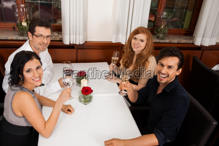 happy laughing group people in restaurant