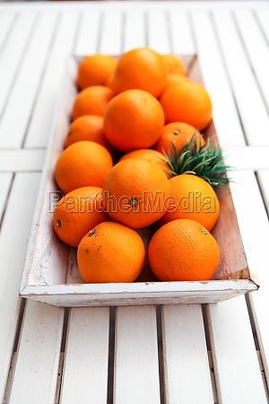 fresh healthy orange in a wooden