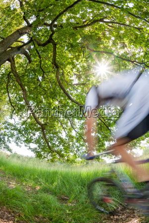 cyclist in blurred motion riding a