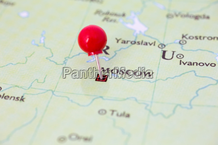 red pushpin on map of russia