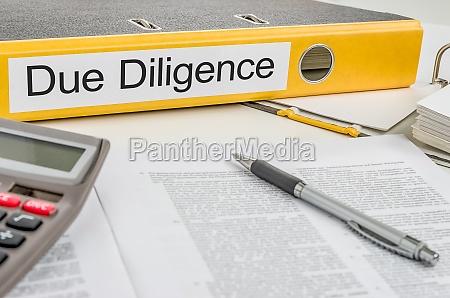 file folders labeled due diligence