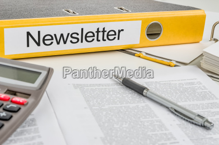 file folders labeled newsletter