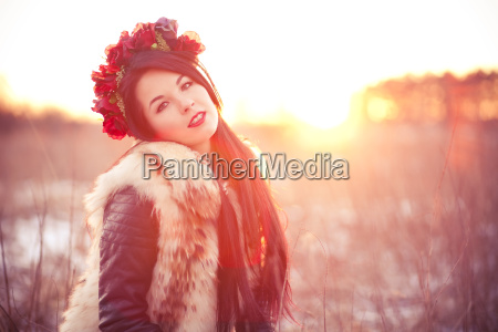 young woman in fur vest