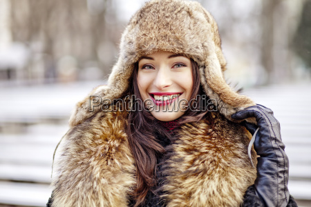 girl smiling in fur hat and