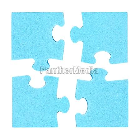 vier puzzleteile kombiniert kooperationskonzept