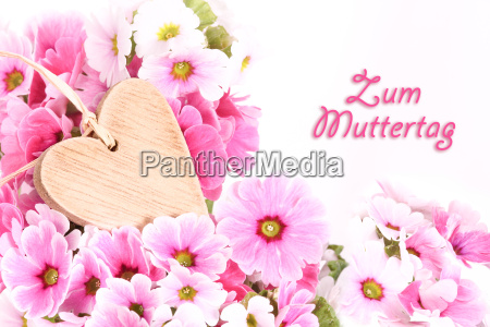 wooden heart with primroses mother