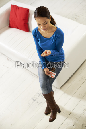 asian woman holding pills and medicine