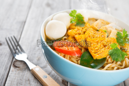 spicy curry instant noodles with fork