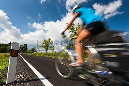 female cyclist biking on a country