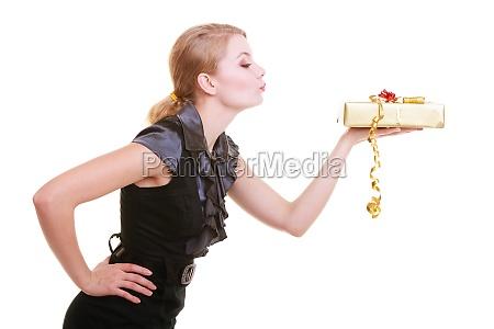 blond girl in black dress holding