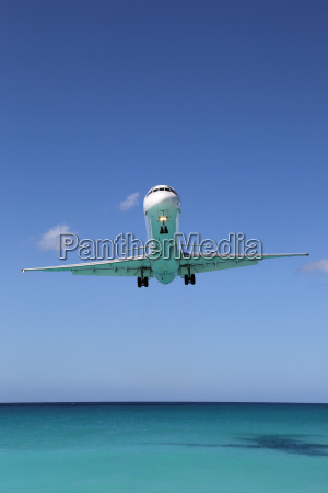 airplane lands at the sea during