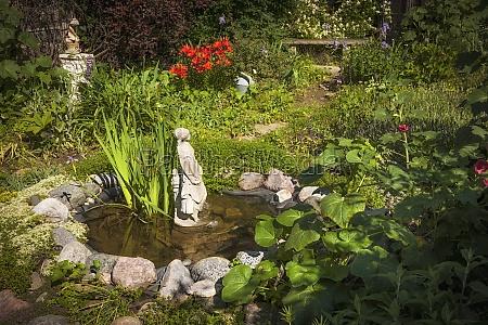 garden pond with statue