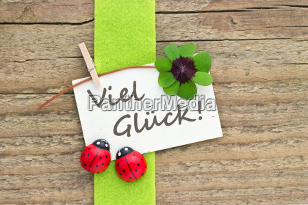 german text lettering four leaf clover