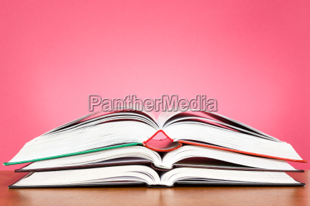 open books on the wooden table
