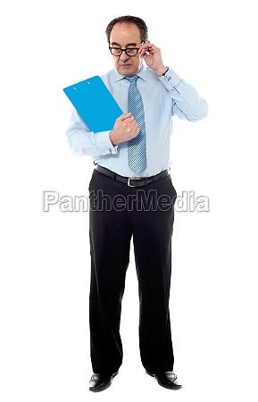 senior corporate man taking a close