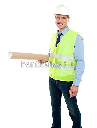 smiling young architect holding blueprint