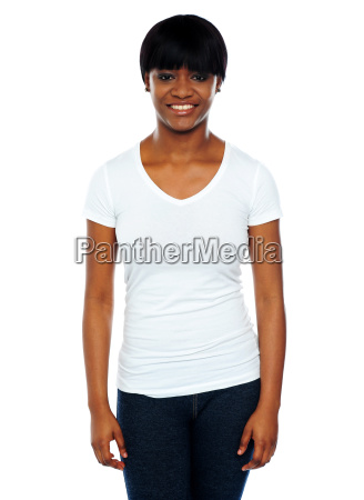 happy young african woman standing