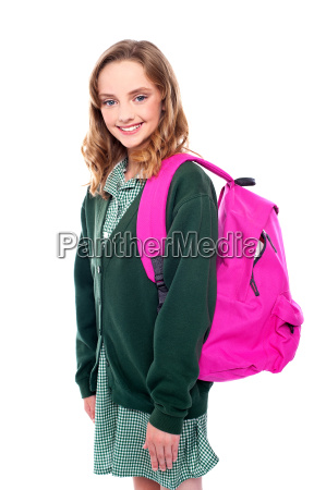 school girl carrying bag on shoulders
