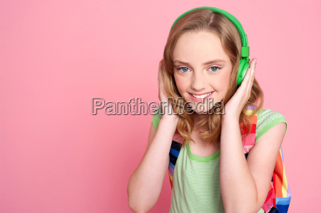pretty girl enjoying music on headphones