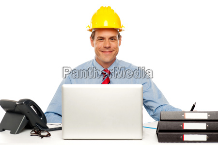 architect wearing safety hat and using
