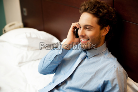 young man conversing on mobile phone