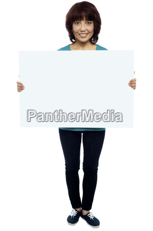 asian female model cheerfully holding blank