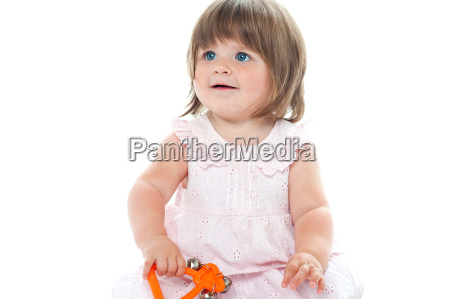 adorable blonde infant playing with a