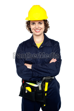 confident female worker posing with arms